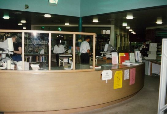 Image of Northcote library with round customer service desk before refurbishment