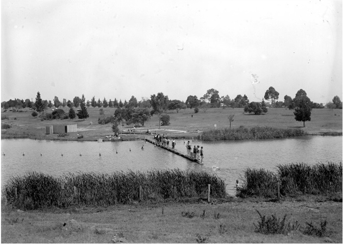 Image of Edwardes Lake. There are people in swimsuits.
