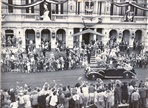 Queen Elizabeth II and Prince Phillip passing in front of Northcote Town Hall, 1954